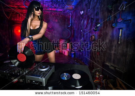 stock-photo-beautiful-sexy-dj-girl-working-on-a-party-in-the-old-garage-151460054
