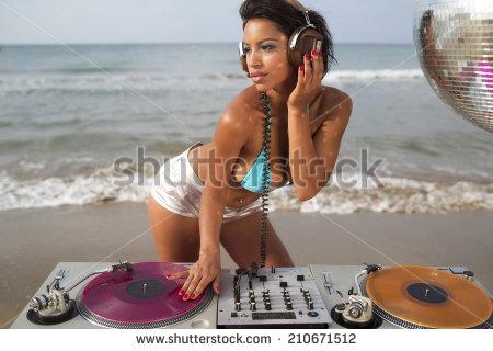 stock-photo-beautiful-sexy-latin-bomb-shell-djing-at-a-beach-in-the-early-morning-useful-for-style-fashion-and-210671512
