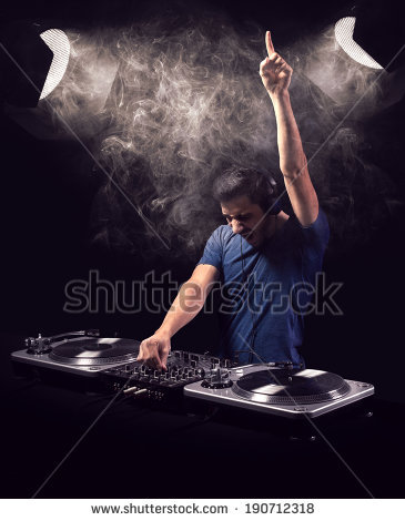 stock-photo-deejay-being-excited-while-playing-music-from-vinyl-with-one-raised-hand-he-is-illuminated-by-two-190712318