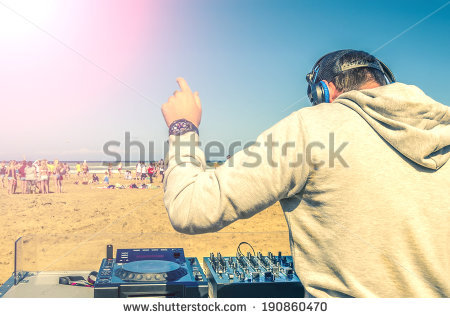 stock-photo-dj-playing-music-at-a-beach-party-190860470